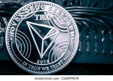 Coin cryptocurrency Thron on a grey shiny background. TRX.