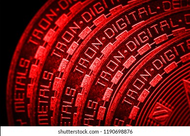 Coin cryptocurrency tron closeup on red black background.