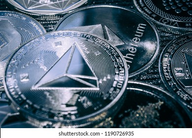 Coin cryptocurrency Tron on the background of the main altcoins Ethereum, dash, monero, litecoin, Iota.