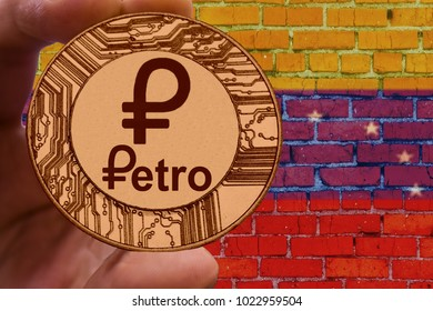 Coin Cryptocurrency Venezuela Petro on the background of the flag of Venezuela on the brick wall.