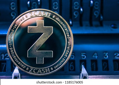 Coin cryptocurrency Zcash on the background of numbers of the arithmometer. Concept mining or Zcash course.