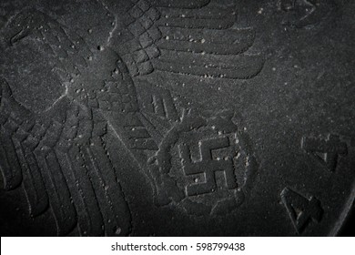 Coin detail money of third reich nazi Germany. Background texture corroded metal of old nazi ten pfennig 1944. Rough grained surface super macro close-up by microscope