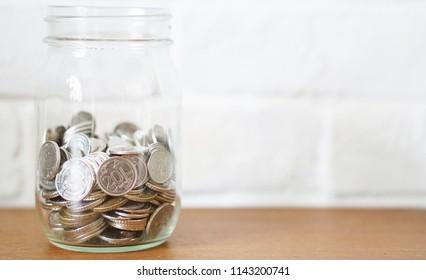 coin finance money in the glass jar