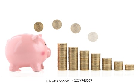 Coin is getting into piggy bank isolated on white. Concept of saving money