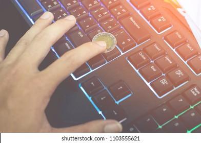 coin hand keyboard Blue light Green light Orange light