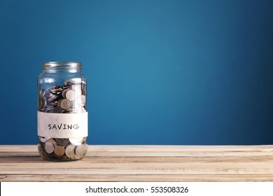 coin into jar with text saving