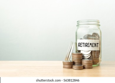 Coin in jar with money stack word retirement, Concept business finance and investment