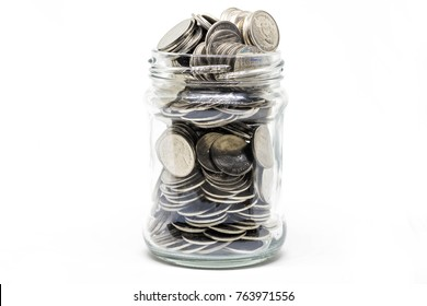 Coin in a jar on white background. Business financial and saving money concept.