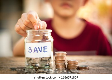 Coin in a jar. Saving money concept for life,future,education with money coin stack for growing on wooden table.