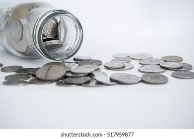 coin money in the bottle with white background.Image with selective focus