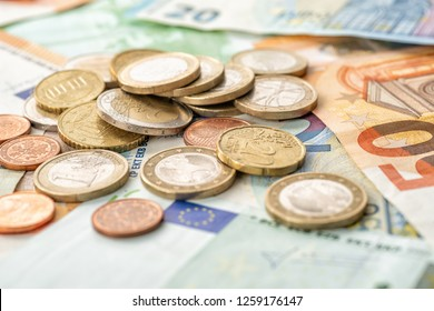 Coin money and euro bills