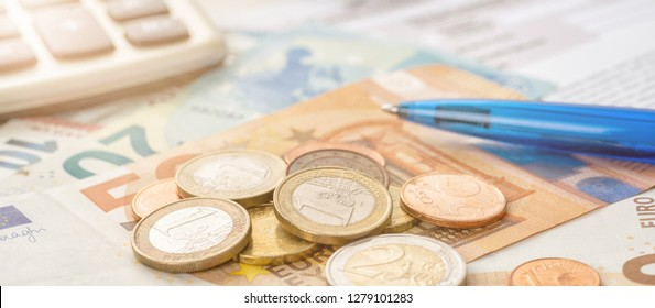 Coin money and euro bills with a calculator