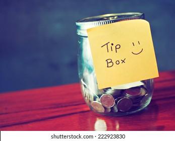 coin in money jar Tip box