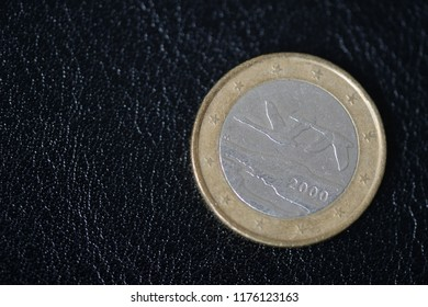 Coin in one euro on a dark background close up