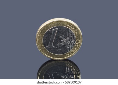 Coin of one Euro on gray background