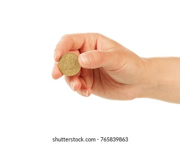 Coin one hryvnia in female hand isolated on white background