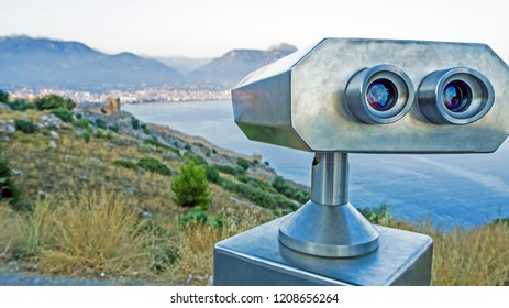 Coin Operated Binocular viewer next to the waterside promenade in Antalya the Bay and city. Observation deck - binocular with  telescope Turkey. Concept of travel and tourism. Beautiful panorama