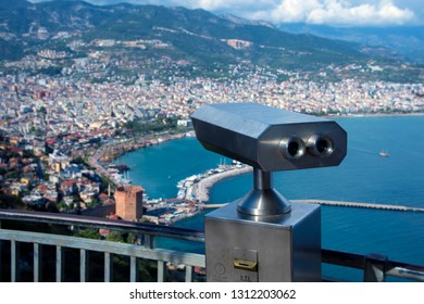 Coin Operated Binocular viewer next to the waterside promenade in Antalya the Bay and city.