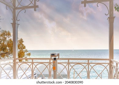 A coin operated binocular viewer for tourists of the beach pier is installed on the Black Sea coast. Odessa. Ukraine