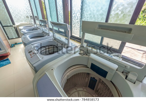 Coin Operated Laundry Shop Washing Machine Stock Photo (Edit