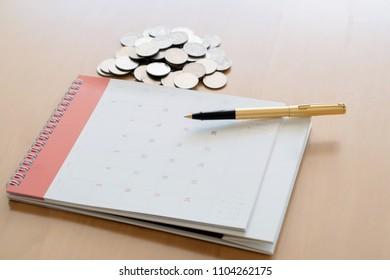 Coin pen and calendar