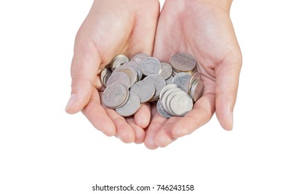 Coin pile (Thailand coins) in woman hand isolated on white background, File contains a clipping path