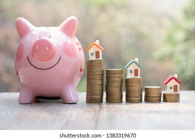 Coin pile and toy house, credit concept by house, money from coins, business, finance and money. Successful financial business concepts. Savings for real estate project with small model.