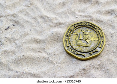 Coin pirate over sea sand