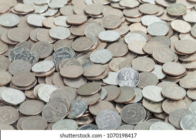 coin in quarter dollar against the background of the Russian coins in 5 rubles.