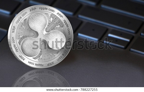 Coin ripple xrp (crypto currency) close-up. On computer background, with a great place for your text