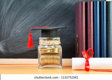 Coin with save in the jar bank and certificate and book put on the table on blackboard background in home, Planning for education in the future concept.