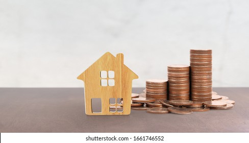 Coin stack house model savings plans for housing,home and Real Estate concept