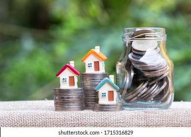 coin stack with house model, savings plans for housing ,financial concept,Concept of real estate investment.