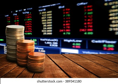 coin stack on old wooden floor with blur perspective stock market number background