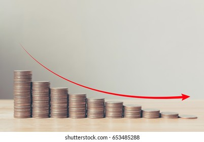 Coin stack step down graph with red arrow, Risk management business financial and investment, Copy space
