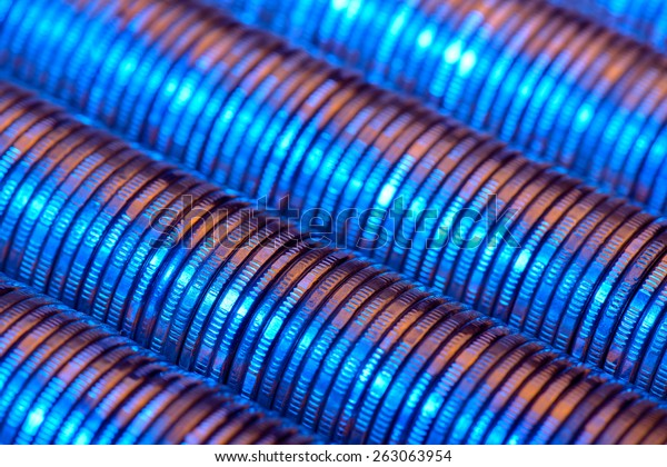 Coin stacks with blue and purple light on it