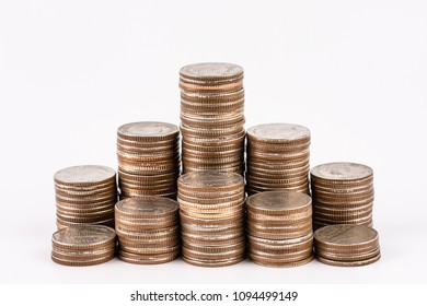 Coin stacks isolated on white background. Saving, Investment money concept. Coin stack growing business.