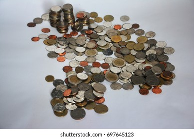 Coin stacks on a white background. Baht coins. Baht money. Baht currency. Coins stacked on each other in different positions. Money concept.