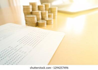 Coin stacks and savings account passbook