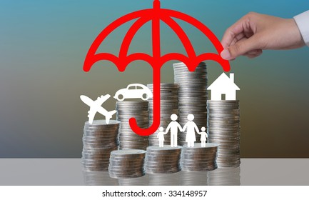 Coin stacks with travel , family , home and car with the protect umbrella on dark background , business idea and insurance concept