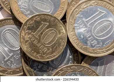Coin ten rubles on a background paper notes worth a hundred rubles