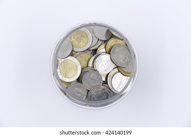 coin thai in glass jars on white background