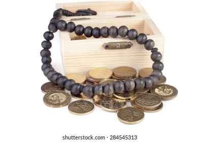 Coin in wooden box-Islamic finance concept