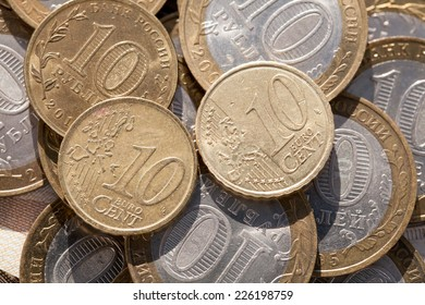 Coin worth ten cents on the euro coins against ten rubles