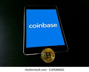 Coinbase cryptocurrency exchange logo on ipad smart device. Copenhagen / Denmark - 08 05 2018