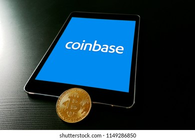 Coinbase cryptocurrency exchange logo on ipad smart device. Copenhagen / Denmark - 08 05 2018