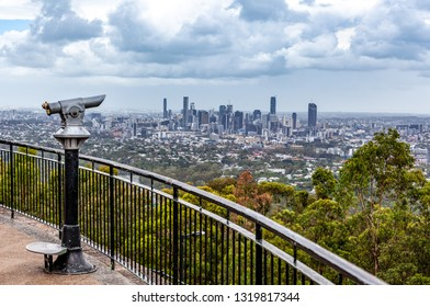 Coin-operated binoculars pointed at Brisbane CBD skyline from lookout
