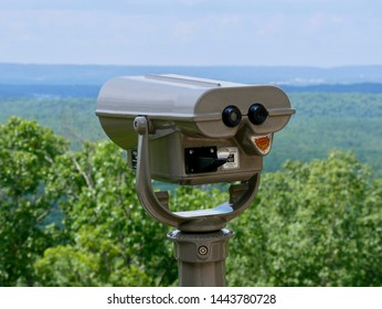 Coin-operated scenic viewing scope over looking mountains. Also known as coin-operated binoculars, tower viewers, observation viewers or sightseeing viewers.