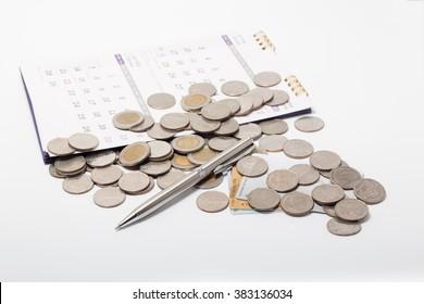 coin,pen,and calendar