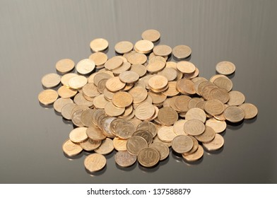 coins against black background